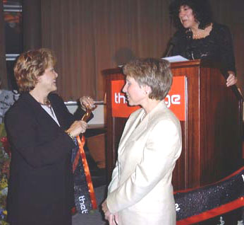 Judith Rodin and Shari Redston cutting the ribbon