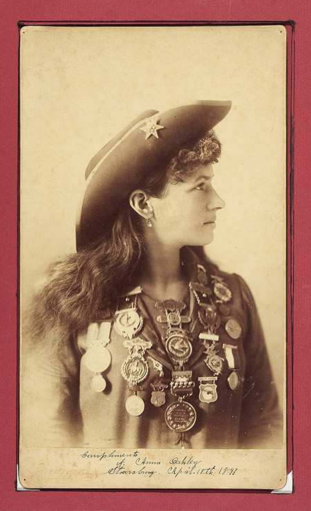 caption: Annie Oakley, London 1891