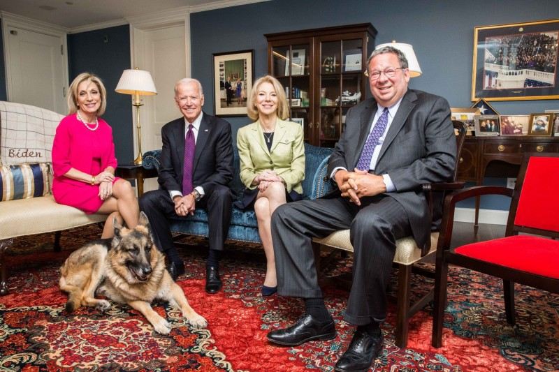 caption: Journalist Andrea Mitchell with the 47th Vice President of the U.S. Joe Biden, Penn President Amy Gutmann, Penn Trustees Chairman David L. Cohen and Mr. Biden's dog, Champ, in the Penn Biden Center for Diplomacy and Global Engagement in Washington, D.C.
