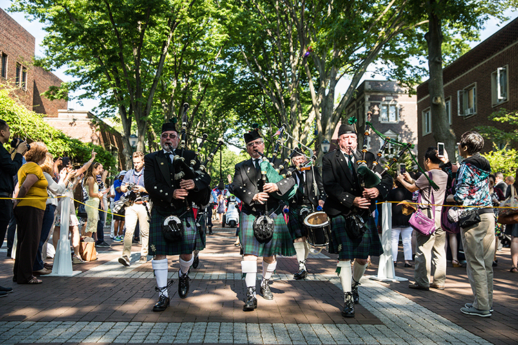 caption: The bagpipers could be heard leading the way through campus.