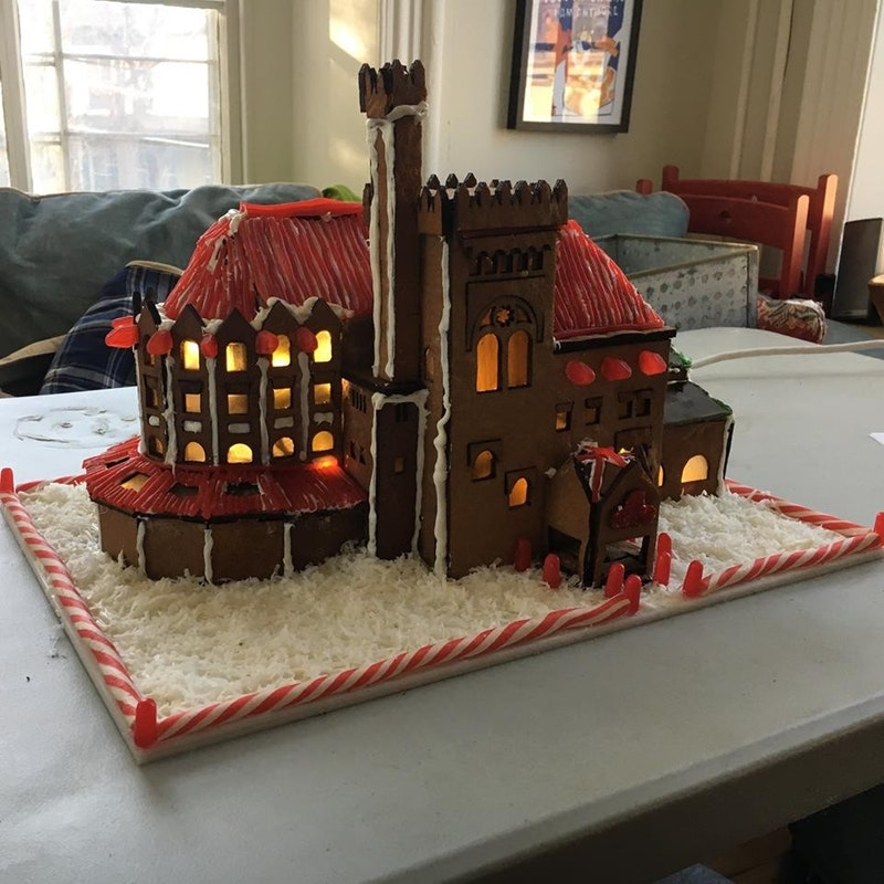 caption: A gingerbread replica of Fisher Fine Arts Library.