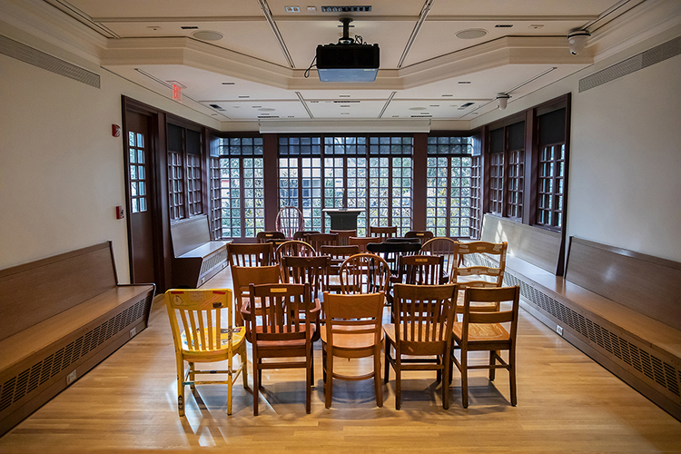 caption: A call to the Writers House community helped them find new, old wooden chairs to fill the more spacious Arts Cafe. Photo by Eric Sucar, University Communications.