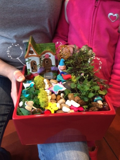 caption: A miniature indoor garden created in the Whimsical Fairy Garden class.