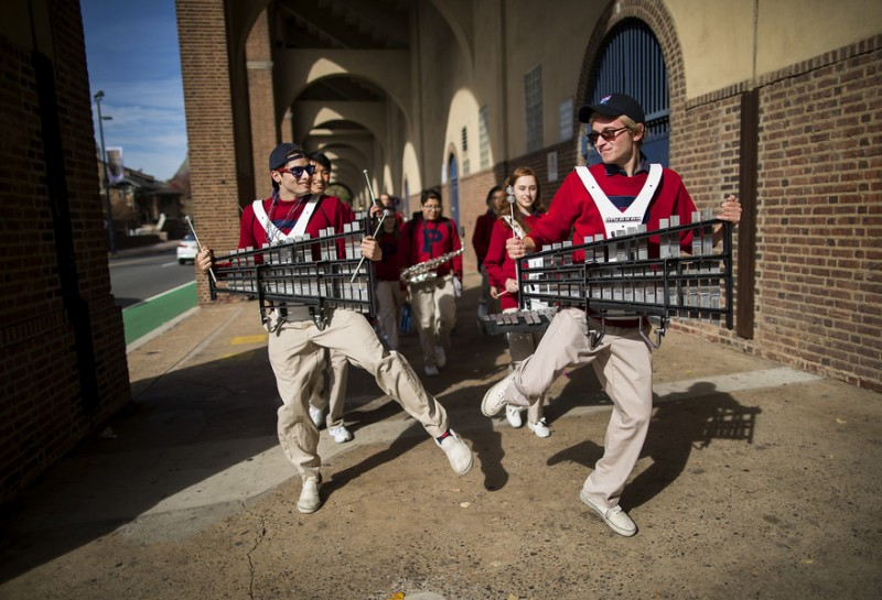 caption: Steven Meisler, EAS'17 (left) and Jackson Betz, C'19 (right), along with their fellow bandmates, make their way to Franklin Field as part of the 2017 Homecoming festivities on November 4, 2017.