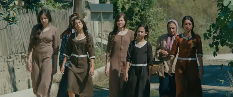 caption:A scene from the film, Mustang, which tells the story of five orphaned sisters in a Turkish village who live under strict rule while arranged marriages are prepared for them.